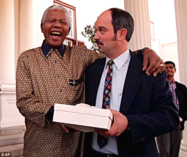 Friends for life: Nelson Mandela bursts out laughing with Christo Brand, his former guard from Pollsmoor Prison who had dropped by his home for his birthday in 1998.
