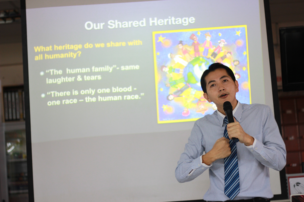 Dr. Teh, explaining, about, Global Peace Foundation