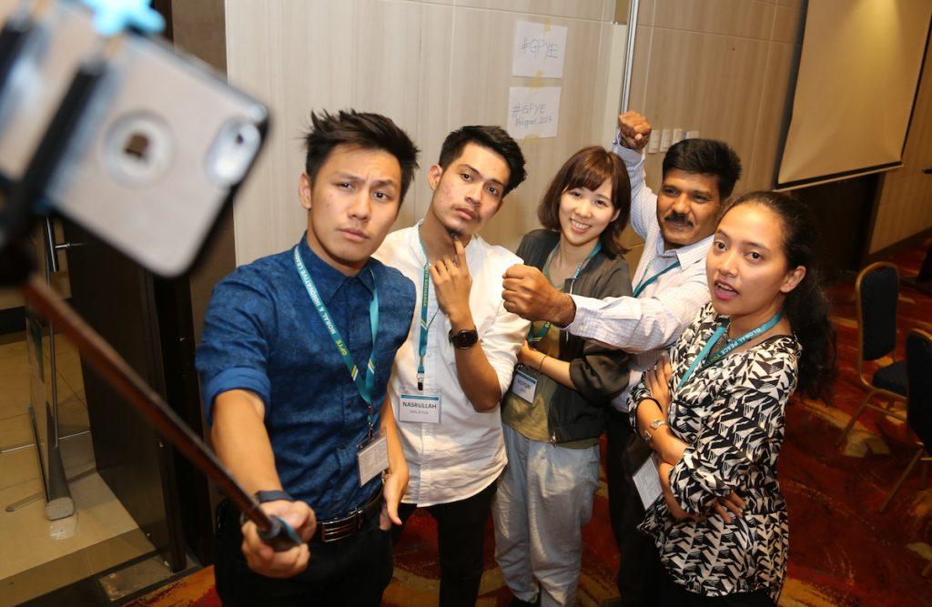 youth taking photos