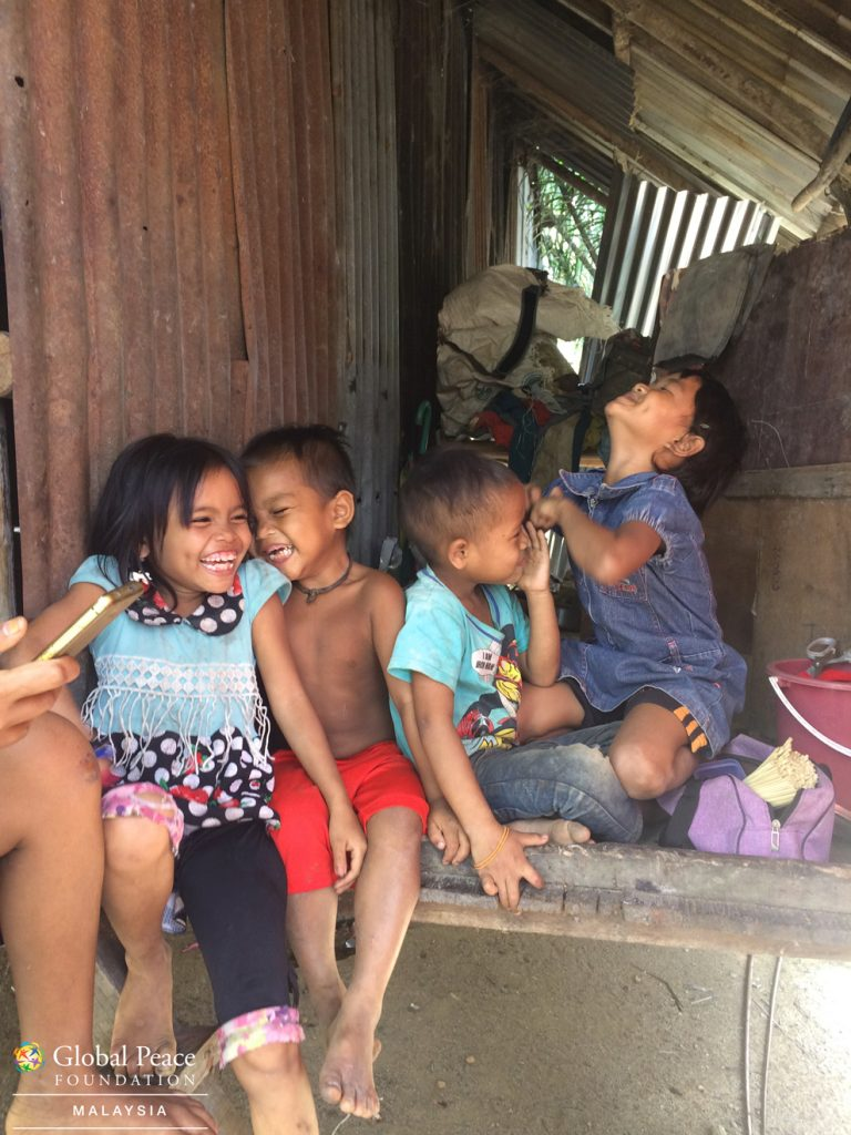orang asli kids laughing