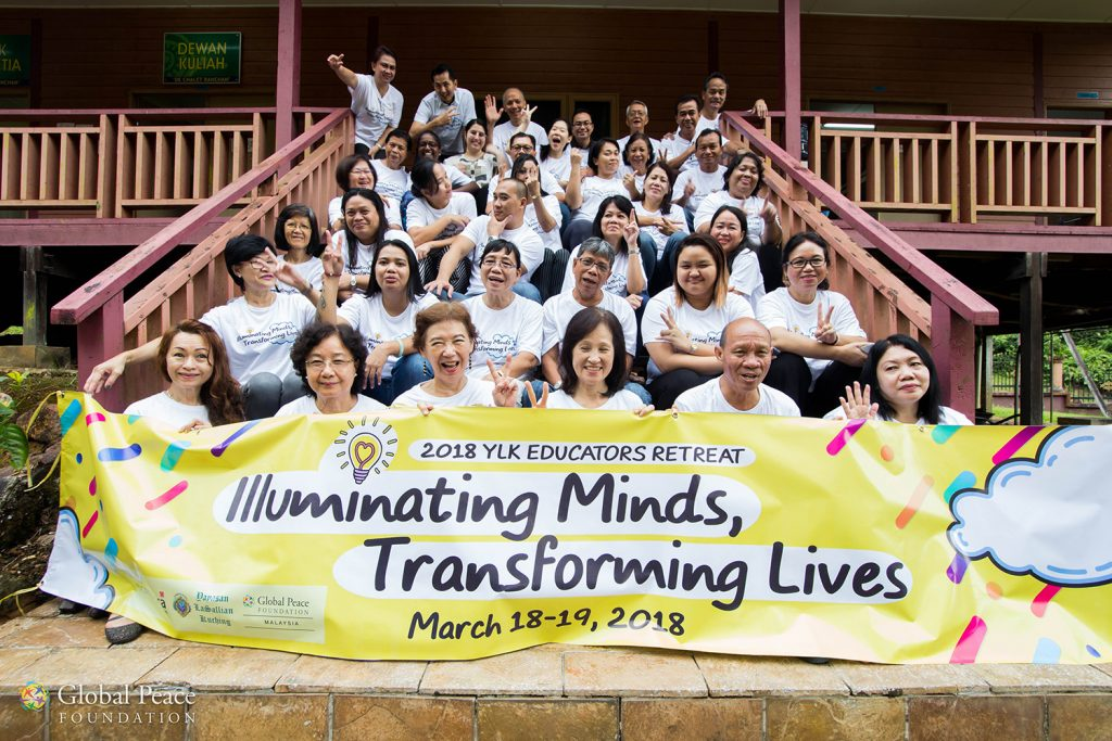 participant's pose with retreat banner
