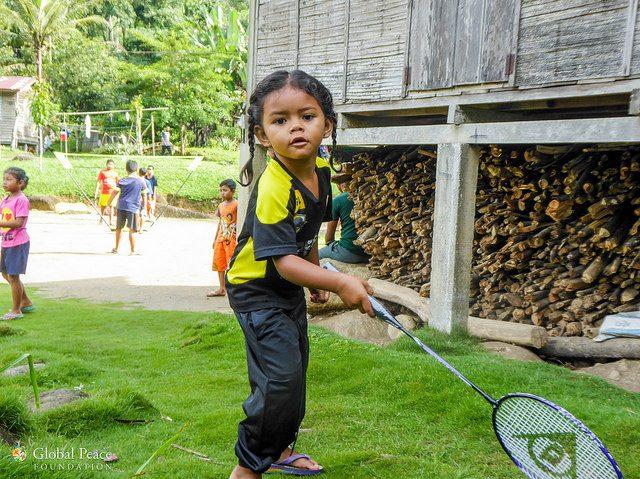 Orang asli child playing badminton in Ulu Geroh