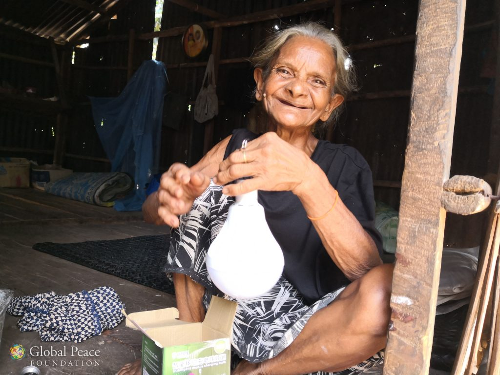 Nenek Jamilah showing us her USB lamp that she purchased from a peddler that comes to her village every few days.